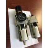 Pressure regulator with metal filter and oiler